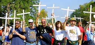 Group of protesters holding up crosses.