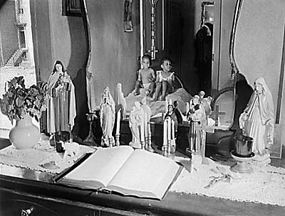 Altar in the bedroom of Mrs. Ella Watson.