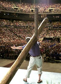 Joe White stands with Cross before a sea of Promise Keepers.